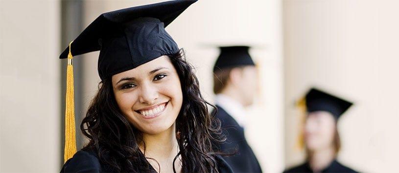 Graduate smiling for the camera