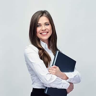 Business woman smiling and holding a laptop.
